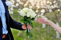 Groom gives the bride a beautiful wedding bouquet Stock Photography