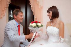 The groom gives bride a wedding bouquet Royalty Free Stock Image