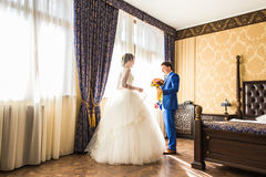 Groom giving bouquet to his bride Royalty Free Stock Photo