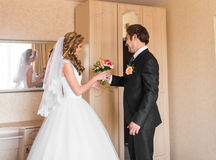 Groom giving bouquet to his bride Royalty Free Stock Image