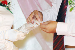 Groom giving an engagement ring to bride Royalty Free Stock Photography