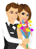 Groom giving his bride a bouquet of flowers Royalty Free Stock Image