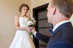 Groom giving to bride wedding bouquet Stock Photos