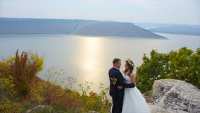 The groom goes to the bride shot in slow motion stock video footage
