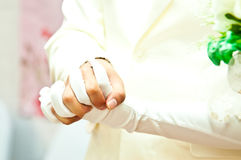 Groom grabs bride's hand on wedding day Stock Images