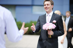 Groom greeting best man royalty free stock photos