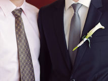Groom and Groomsman. Groom with calla boutonniere and groomsman stock image