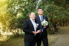 A groom and groomsman came to the bride. The groom and groomsman came to the bride stock photos