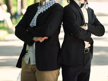Groom and Groomsman. Groom with groomsman standing in park royalty free stock photo