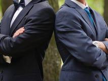 Groom and Groomsman. Standing shoulder to shoulder royalty free stock image