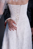 Groom Hand On Brides Dress Stock Image