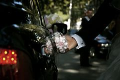 Groom hand opening limousine door Royalty Free Stock Photo