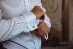 Groom hands with cufflinks. Elegant gentleman clother, white shirt Royalty Free Stock Photography