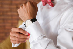 Groom hands fixing his cull links Royalty Free Stock Image
