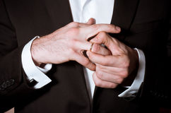 Groom hands takes off a ring Stock Photos