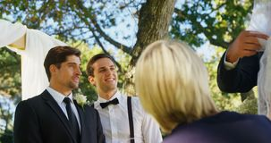 Groom happily looking at bride and her father 4K 4k stock video footage