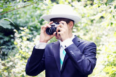 The groom in a hat with a camera, tinted Stock Photo