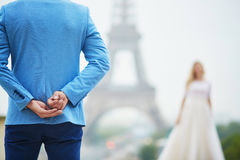 Groom hiding the wedding ring behind his back Royalty Free Stock Images