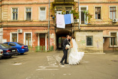 The groom and his bride in courtyard. Stock Image