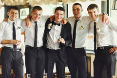 Groom and his friends pose in a restaurant Stock Photo