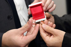 Groom and his witness carrying a wedding ring closeup Stock Image