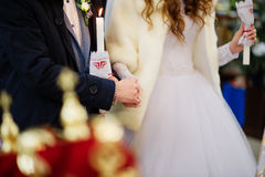 Groom hold brides hand at church on wedding ceremony. Royalty Free Stock Photos
