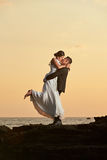 Groom hold and kiss bride Royalty Free Stock Image