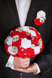 Groom hold wedding bouquet in hand Royalty Free Stock Photos