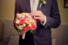 Groom hold wedding bouquet Royalty Free Stock Photography