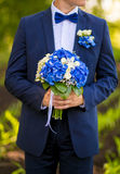 Groom hold wedding bouquet Stock Image