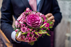 Groom hold wedding bouquet Royalty Free Stock Image