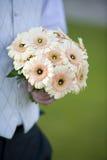 Groom holdin a wedding bouquet Royalty Free Stock Photos