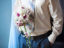 Groom is holding beautiful flowers bouquet Royalty Free Stock Photos