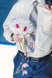 Groom is holding beautiful flowers bouquet Stock Photography