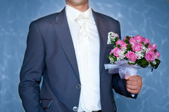 Groom holding beautiful wedding bouquet Stock Photo