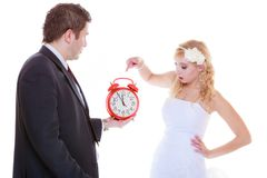 Groom holding big red clock yelling and bride Royalty Free Stock Images