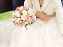Groom Holding Bride with Bouquet Royalty Free Stock Photo