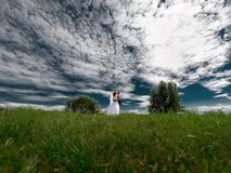 Groom holding bride dance in beautiful nature stock photos