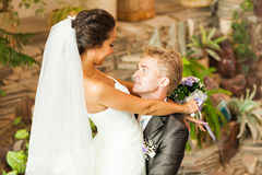 Groom holding bride in dance pose on wedding day Royalty Free Stock Photo