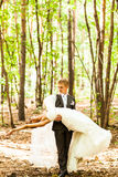 Groom holding bride in dance pose on wedding day Stock Photography