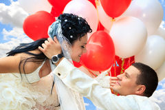 Groom holding bride flying away stock images