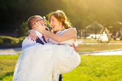 Groom holding bride in his arms Royalty Free Stock Photography