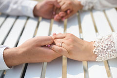 Groom Holding Bride`s Fingers Royalty Free Stock Image