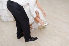 Groom Holding Bride's Leg Stock Images