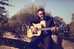 Groom holding a guitar. Capture of Groom holding a guitar stock photography