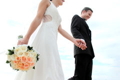 Groom holding his bride hand Royalty Free Stock Image