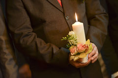 Groom holding a lighted candle Royalty Free Stock Photo