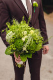 Groom holding rustical wedding bouquet Royalty Free Stock Photos