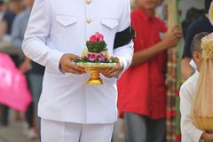 Groom holding tray of gifts or Khan makk in Thai traditional wedding ceremony. Royalty Free Stock Photography