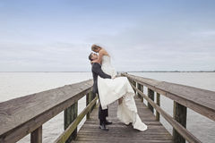 Groom holding up his bride Royalty Free Stock Images